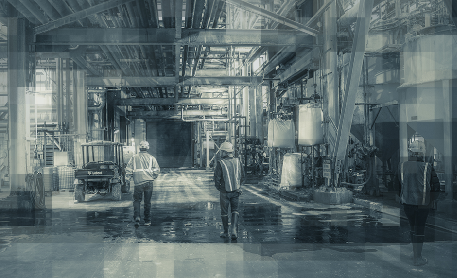Artistic photo of mining employees in mining facility in Wyoming
