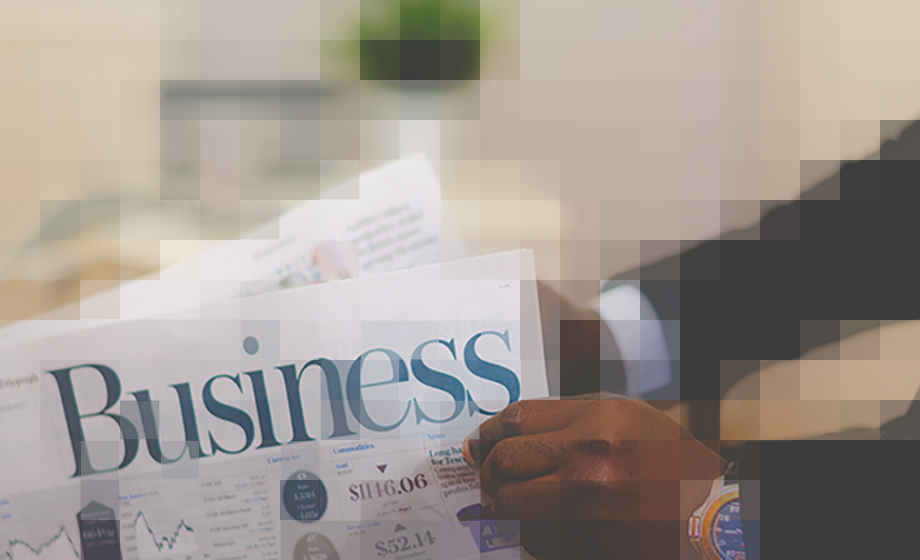 Photo of businessman reading the business news