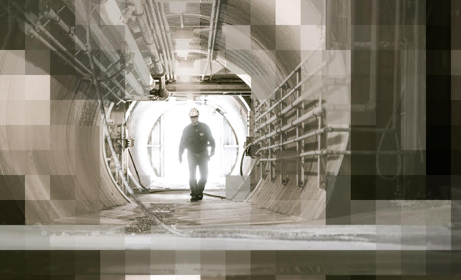 Graphic showing a worker walking in a soda ash processing facility